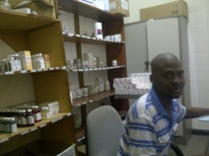 Mr. Sello Lechesa, a pharmacy technician and RxSolution user in the ART pharmacy at Maluti Adventist hospital. Photo by MSH Staff/Lesotho.