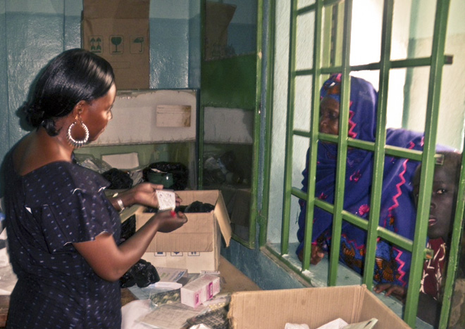 The manager of a community health center dispenses family planning commodities in Mali. {Photo credit: MSH.}