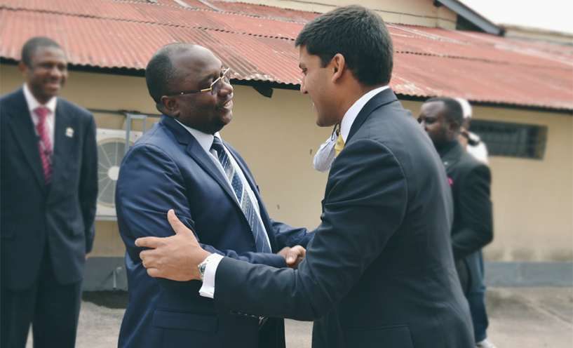 USAID Administrator Rajiv Shah (right) is welcomed to Democratic Republic of the Congo (DRC) by Minister of Health Dr. Felix Kabange. Photo credit: MSH.