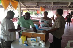 Supportive supervision of a Malaria Service Deliverer diagnosis and treatment kit at a gold-mining camp in Suriname. (Photo credit: John Marmion)