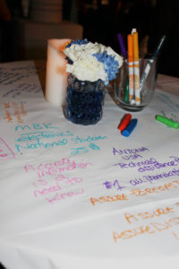 Notes and doodles of the evening's discussions on one of the tables. | Photo Credit: Kiley Workman