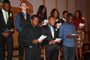 The first graduating class of trained pharmacists from the University of Namibia's School of Pharmacy take the pharmacy oath on April 23, 2014.
