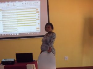 Strategic Information Analyst Mavis Magongo presents CMS's newly adopted Key Performance Indicators (KPIs) on the last day of the training.