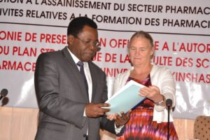 Higher Education Minister Théophile Mbemba Fundu and USAID DRC Mission Director Diana Putman at the launch of the country's first strategic plan for pharmacist training.